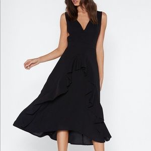 Black ruffled dress with criss cross straps